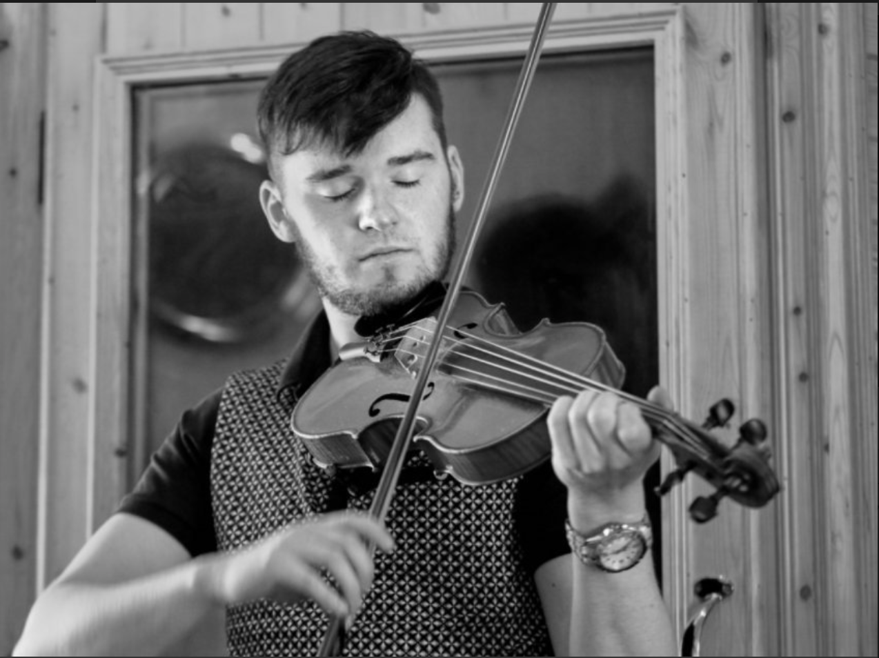 Aidan Connolly playing fiddle - black and white photo