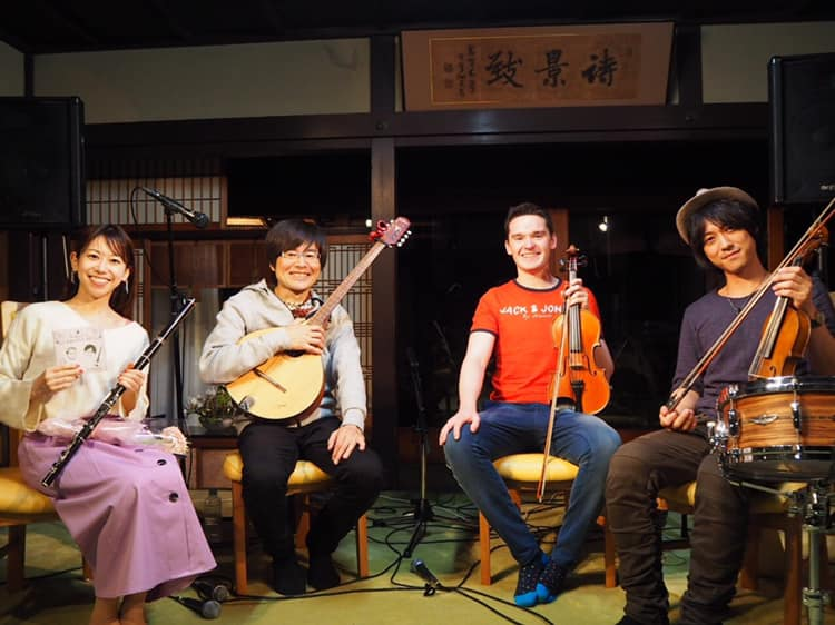 Photo of Aidan Conolly in concert with Japanese group