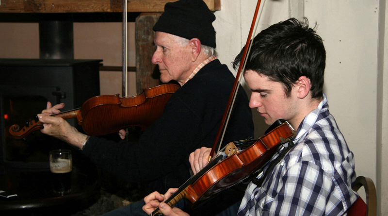 Aidan when younger playing fiddle with legendary fiddle player Paddy Cronin