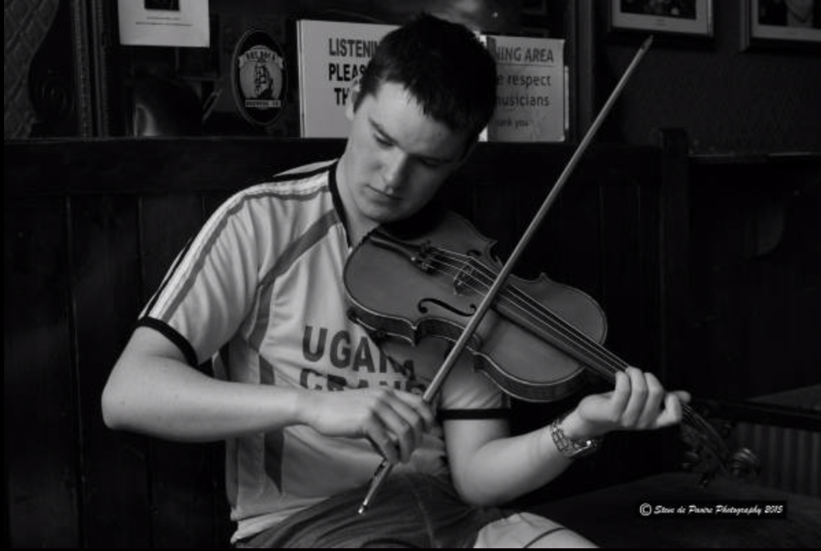 Young Aidan Connolly playing fiddle in The Cobblestone Pub, Dublin
